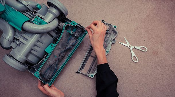 cleaning and replacing vacuum cleaner parts in Edmonton